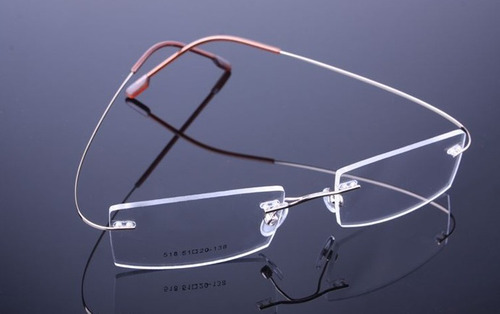7404149c97e66 Armação Dourada Óculos De Titanium Super Leve Sem Aro - A578. R  69.99