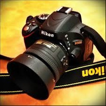 Nikon D5100 + Lente 35 Mm 1.8 + Cartão Sd 8 Gb + 2 Baterias