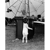 Poster (46 X 61 Cm) Boy Paying For Amusement Park Ride