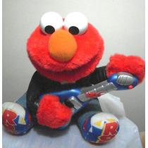 Boneco Elmo Canta Toca Guitarra Vila Sésamo Ler Anúncio