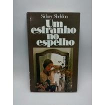 Livro - Um Estranho No Espelho - Sidney Sheldon ©