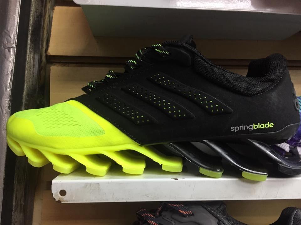 novo adidas springblade preto com verde